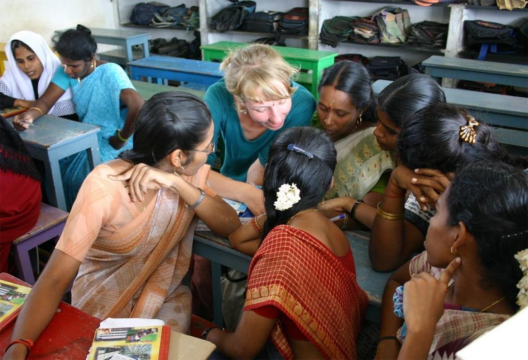 Women's Empowerment volunteer assists her class during an English lesson in India.